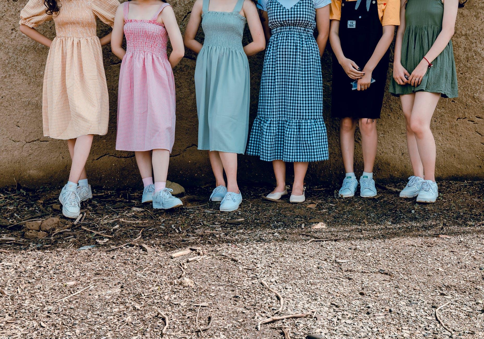 women standing wall