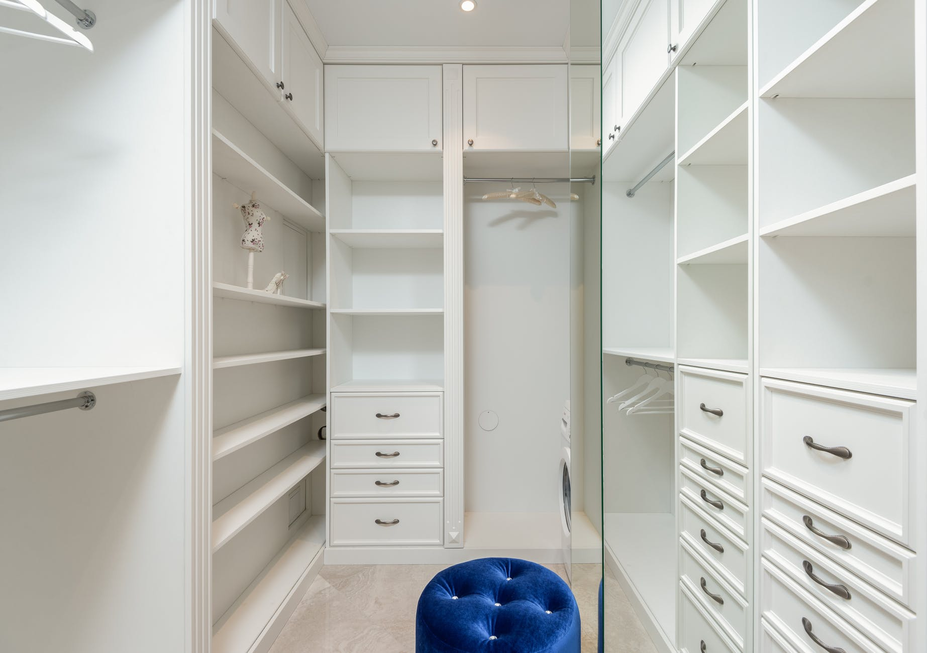 white classic styled built in wardrobe with empty shelves